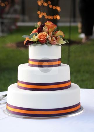 Wedding cake stock photo, Beautiful wedding cake topped with fresh flowers by allihays