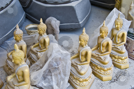 Buddha statues stock photo, little dusty buddha statues in a thai temple by Juliane Jacobs