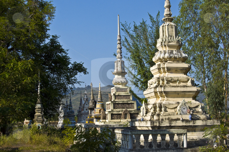 Old cemetery stock photo, beautiful old colorful chedis on a a thai cemetery by Juliane Jacobs