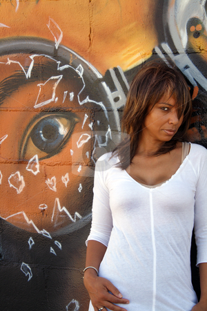 Beautiful Mature Black Woman with Graffiti (8) stock photo, A lovely mature black woman stands in front of a wall of graffiti art. by Carl Stewart