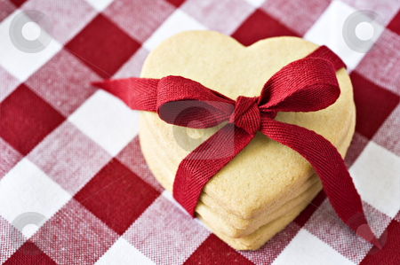 Heart shaped cookies with a red ribbon stock photo, Heart shaped cookies with a red ribbon on cloth by tish1