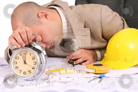 A businessman sleepy with architectural plans stock photo, A businessman sleepy with architectural plans at desk by vladacanon1