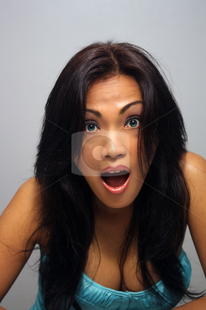 Beautiful Shocked Asian Girl stock photo, A lovely young Indonesian model with long, luscious black hair, arresting blue eyes, and a shocked or disbelieving facial expression. by Carl Stewart