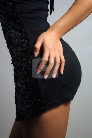 Close-up of a Female Hand on Her Hip (1) stock photo, Side view of a perfect female figure with her hand resting on her hip. by Carl Stewart