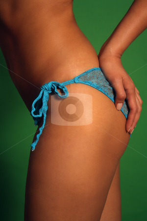 Close-up of a Female Hand on Her Hip (2) stock photo, Side view close-up of a perfect female figure with her hand resting on her hip. by Carl Stewart