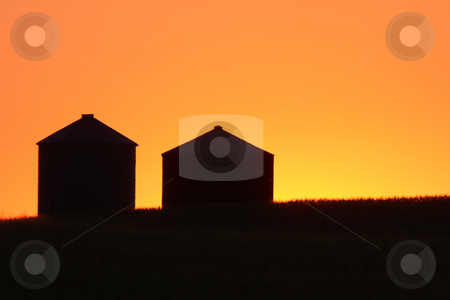 Twilight and granary silhouettes stock photo, Twilight and granary silhouettes by Mark Duffy