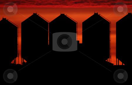 Set sun backlighting farm buildings stock photo, Set sun backlighting farm buildings by Mark Duffy