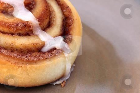 Yummy Cinnamon Bun stock photo, A cinnamon bun sitting on a plate. by Chris Hill