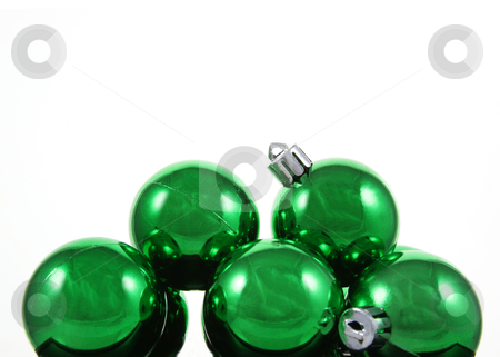 Green Bauble Pile stock photo, A bunch of green Christmas baubles against a white background.  by Chris Hill