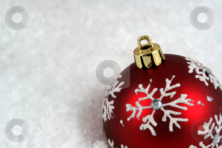 Snowflake Xmas Bauble Upclose stock photo, A snowflake Christmas bauble sitting in a bed of snow.  by Chris Hill