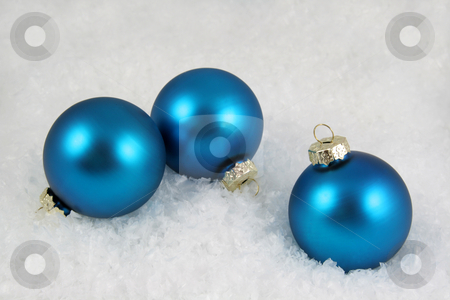 Three Blue Xmas Baubles stock photo, Three blue Christmas baubles sitting in snow. by Chris Hill