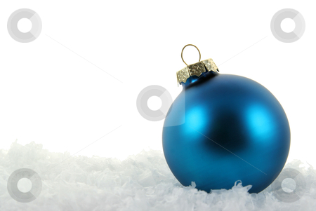 Simple Blue Xmas Bauble stock photo, A blue Christmas bauble sitting in a bed of snow.  by Chris Hill