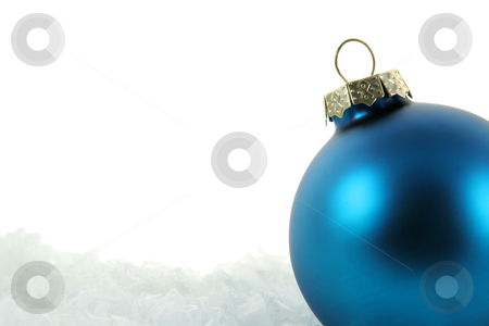 Blue Bauble in the Snow Upclose stock photo, A blue Christmas bauble sitting in a bed of snow.  by Chris Hill