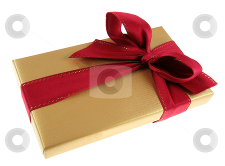 Gold Christmas Box stock photo, A Christmas present wrapped in gold paper with red ribbon.  by Chris Hill