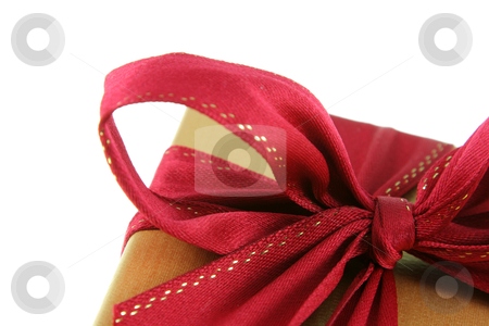 Red Xmas Bow stock photo, A Christmas present wrapped in gold paper with red ribbon.  by Chris Hill