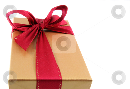 Golden Christmas Present stock photo, A Christmas present wrapped in gold paper with red ribbon.  by Chris Hill