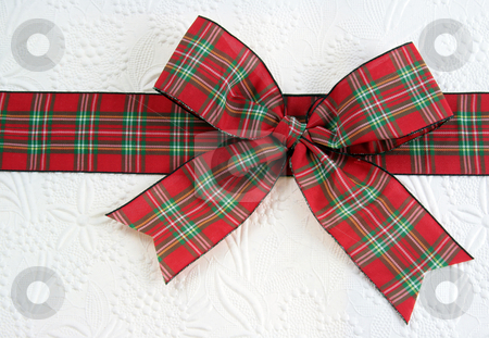 Red Plaid Christmas Bow stock photo, A plaid christmas bow on decorative white paper.  by Chris Hill