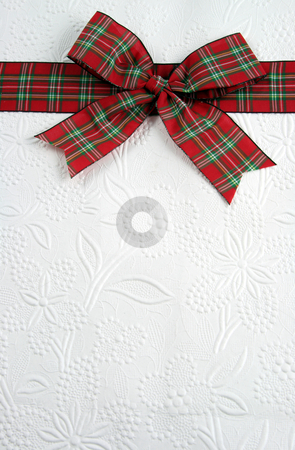 Bow On Top stock photo, A plaid christmas bow on decorative white paper.  by Chris Hill
