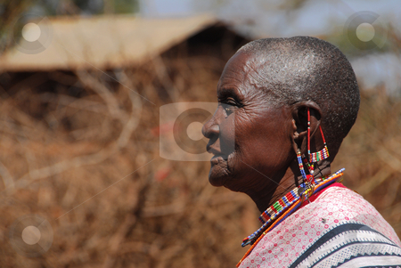 African stock photo, Masai Mara, Kenya July, 2009: a old  Masai woman in the bush wearing the typical jewelry forgings of small colored beads.   by africa