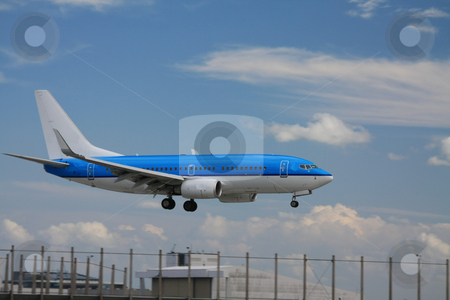 Blue plane approaching runway stock photo, A blue plane just seconds before landing by Porto Sabbia