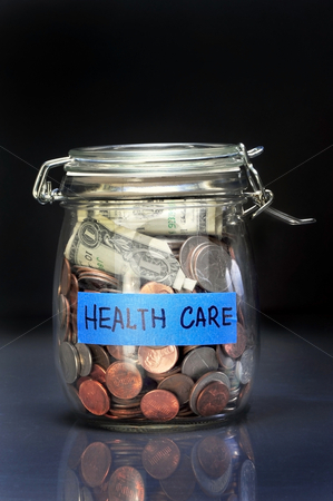 Health Care Jar stock photo, Saving for health care funds. by WScott