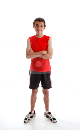 Boy teenager wearing sports gym clothing stock photo, A young boy teenager wearing sports wear clothing, tank top, shorts and  sports shoes and standing with arms crossed.  White background. by Leah-Anne Thompson