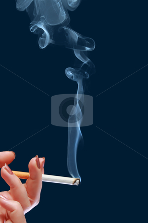 Woman holds in her hand cigarette which produce smoke stock photo, Woman holds in her hand cigarette which produce smoke by Andrey Yanevich