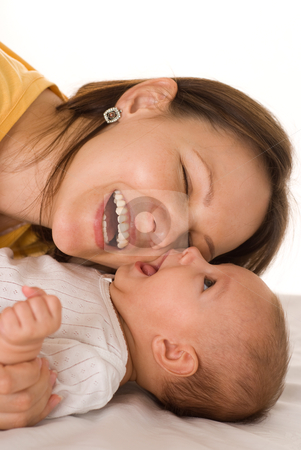 Happy mom and  baby stock photo, happy mom stands and holds the baby by Alevtina Guzova