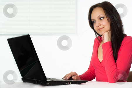 Girl in the red with a laptop stock photo, beautiful girl in the red with a laptop by Alevtina Guzova