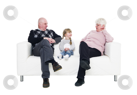 Girl with her grandparents stock photo, Little Girl with her grandparents in a sofa isolated on white background by Anne-Louise Quarfoth