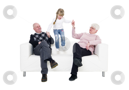 Little Girl with her grandparents stock photo, Little Girl with her grandparents in a sofa isolated on white background by Anne-Louise Quarfoth