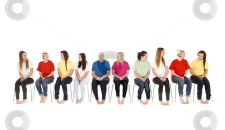 Group of Young women on chairs stock photo, Group of Young women sitting on chairs wearing colorfull t-shirts by Anne-Louise Quarfoth