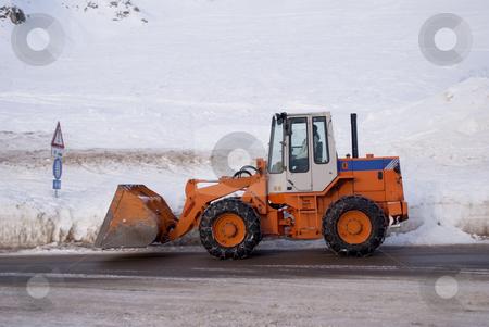 Snowy street stock photo, snowy street in winter in the Italian Alps by freeteo