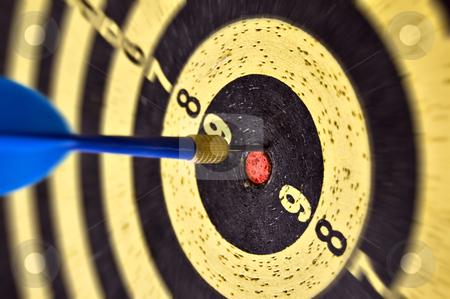 Arrow and target stock photo, Dartboard target and dart arrow. Selective focus. by sirylok