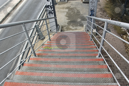 Overpass stairs stock photo, Metal stairs of pedestrian overpass bridge above the motorway. by sirylok