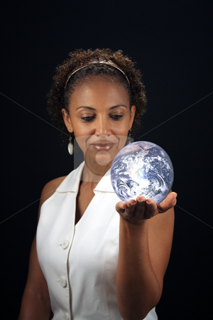 Beautiful Mature Black Woman Holding the Earth stock photo, A lovely mature black woman holds the earth in the palm of her hand.  This photo is available without the earth.  Earth photo credit:  NASA, public domain. by Carl Stewart