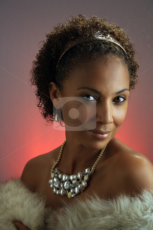Beautiful Mature Black Woman Headshot (2) stock photo, Studio close-up of a lovely mature black woman wearing a fur wrap and a large necklace. by Carl Stewart