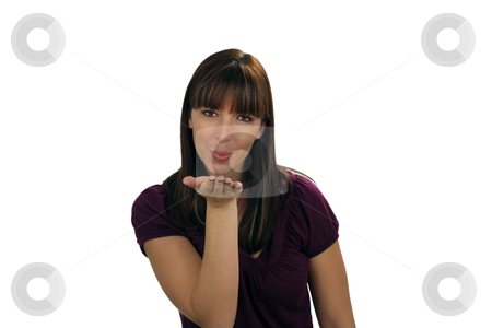 Beautiful Brunette Blows a Kiss (2) stock photo, A lovely young brunette blows a kiss to the viewer with a hint of a smile. by Carl Stewart