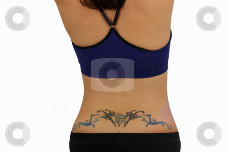 Female Lower Back with a Tattoo stock photo, A close-up of a female lower back with a tattoo design, including a dolphin or porpoise jumping over a crescent moon. by Carl Stewart