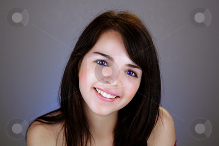 Beautiful Brunette with Electric-blue Eyes stock photo, Studio close-up of a lovely young brunette with a bright, warm smile and electric-blue eyes. by Carl Stewart