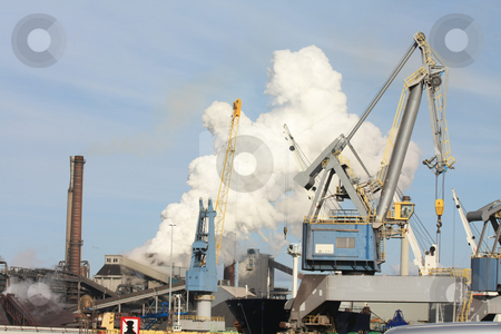 Heavy Industry stock photo, Industrial area with heavy equipment and smoking chimney by Porto Sabbia