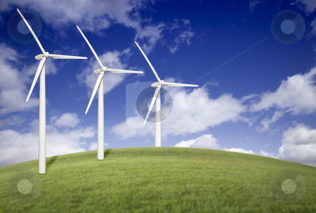 Three Wind Turbines Over Grass Field and Blue Sky stock photo, Three Wind Turbines Over Grass Field, Dramatic Blue Sky and Clouds. by Andy Dean