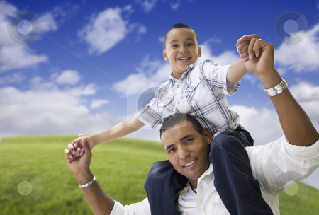 Hispanic Father and Son Having Fun Together stock photo, Hispanic Father and Son Having Fun Together in the Park. by Andy Dean