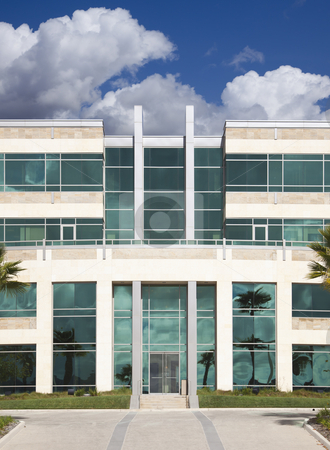 Dramatic Corporate Building stock photo, Dramatic Corporate Building with Blue Sky and Clouds. by Andy Dean