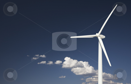 Wind Turbine Over Dramatic Sky and Clouds stock photo, Single Wind Turbine Over Dramatic Blue Sky and Clouds. by Andy Dean