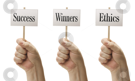 Three Signs In Fists Saying Success, Winners and Ethics stock photo, Three Signs In Male Fists Saying Success, Winners and Ethics Isolated on a White Background. by Andy Dean