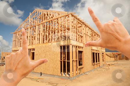 Female Hands Framing Home Frame on Construction Site stock photo, Female Hands Framing New Home Frame on Construction Site. by Andy Dean