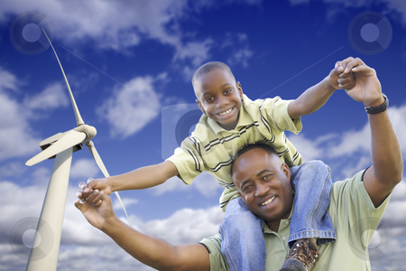 Happy African American Father and Son with Wind Turbine stock photo, Happy African American Father and Son with Wind Turbine Over Blue Sky. by Andy Dean