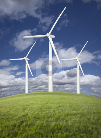 Wind Turbines Over Grass Field, Dramatic Sky and Clouds stock photo, Three Wind Turbines Over Grass Field, Dramatic Sky and Clouds. by Andy Dean