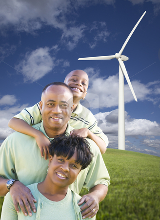 Happy African American Family and Wind Turbine stock photo, Happy African American Family and Wind Turbine with Dramatic Sky and Clouds. by Andy Dean